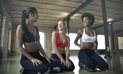 Three women in a sports class chatting