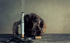 Cigarette next to a skull, quit smoking