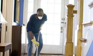 man wearing a mask while cleaning