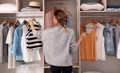 Lady choosing an outfit from her wardrobe