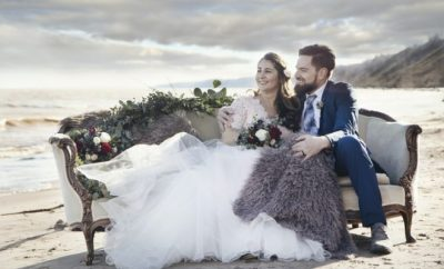 Groom and bride sitting on a bank chair
