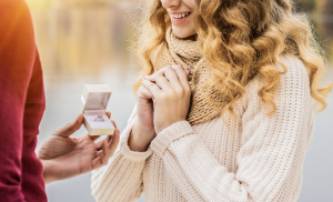 Woman being proposed to with a ring