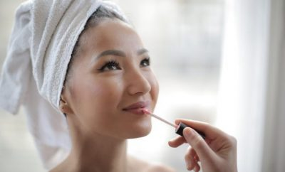 young woman with hoar towel, makeup