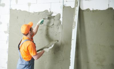 worker plastering a room
