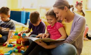 childcarer, mother and child