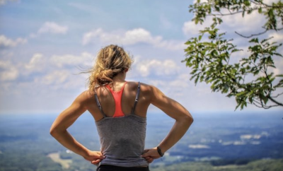 woman looking down a hill after exercise