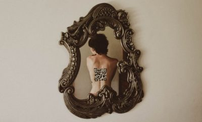 woman's back reflected in a mirror