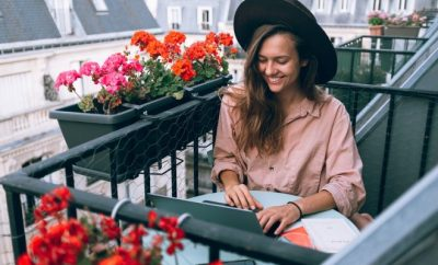 Young lady on her laptop on balcony