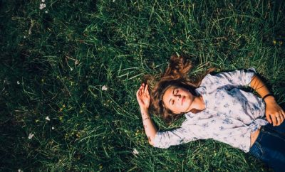 Relaxed woman lying down on the grass