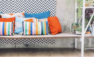 outdoor bank with colourful cushions