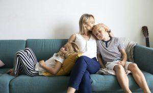 Mother cuddling her children