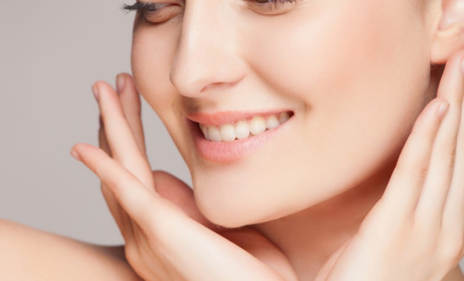 woman smiling with beautiful hands