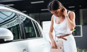 Lady looking for her car keys in her handbag
