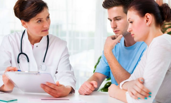 Doctor in consultation with a couple