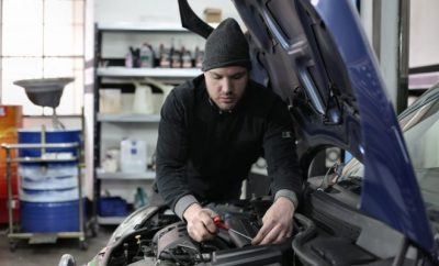 mechanic looking over car, car,