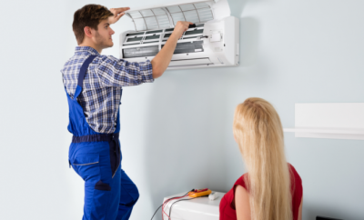 Man installing an air con, cooling system