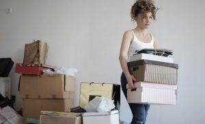 woman carrying boxes to move
