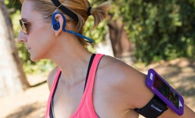 woman jogging with earphones on