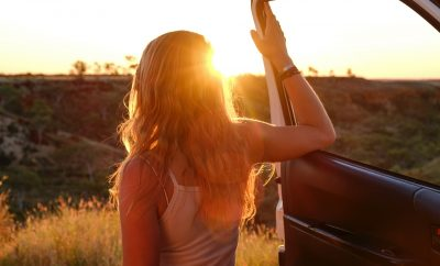 woman on a road trip, sunset,