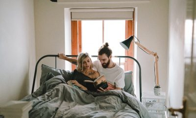 reading couple in bed