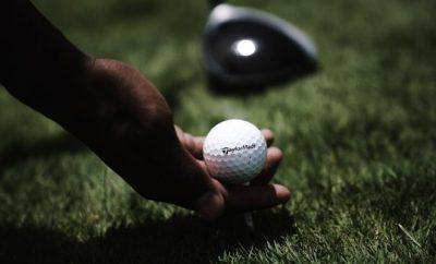 Golfer putting down a golf ball