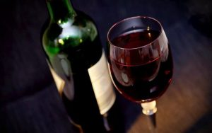 Bottle of red wine and a full glass of wine