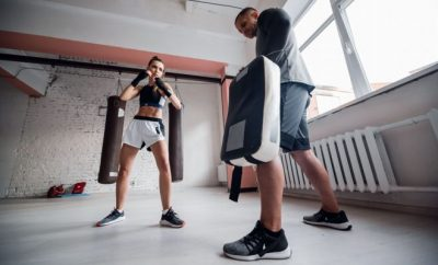 Lady boxing with PT