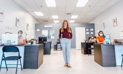 Woman standing up in an office space