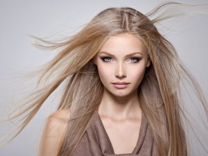 Fashion Hipster girl, Stylish hairstyle. Makeup