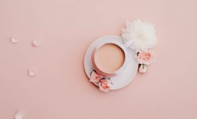 Cup a tea in fine china on a pink tablecloth
