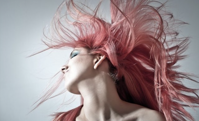 woman with pink blowing hair