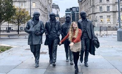 Young girl posing in front of statues