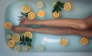 selfcare, woman's legs in bathtub