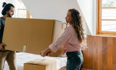 Couple moving packages