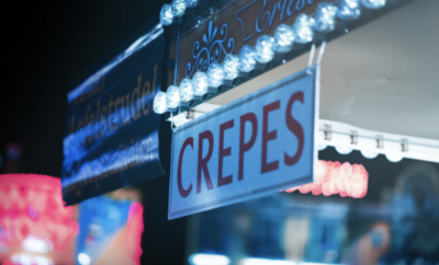 A sign with the word 'crêpe'