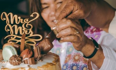 LAdy lighting up birthday candles on acake