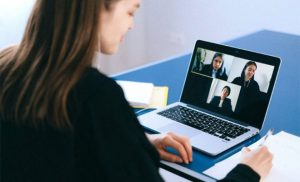 woman conducting a online meeting/interview