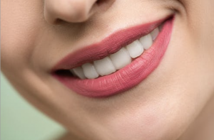 Woman with pink lipstick and smiling