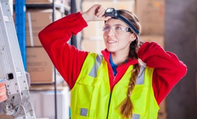 Woman wearing safety glasses at work