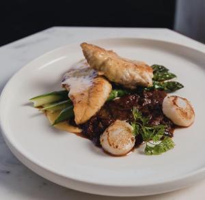 Fish and scallops dish