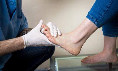 Doctor// nurse looking at a foot