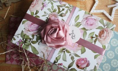 A wrapped present in flower print paper