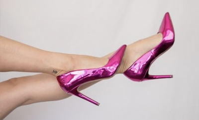 Lady legs with shiny pin shoes