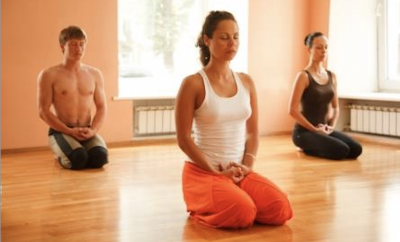 A class doing yoga