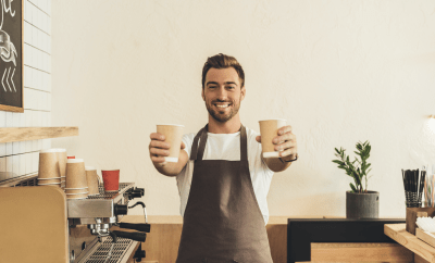 Man offering 2 cups of coffee