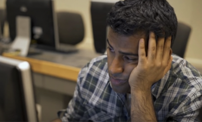 Man looking unfocused in front of the computer