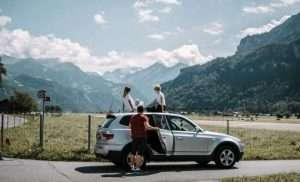 Family on a road trip having a break